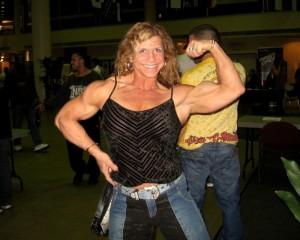 Женская красота в мускулах. Девушка, паурливтинг, бодибилдинг
