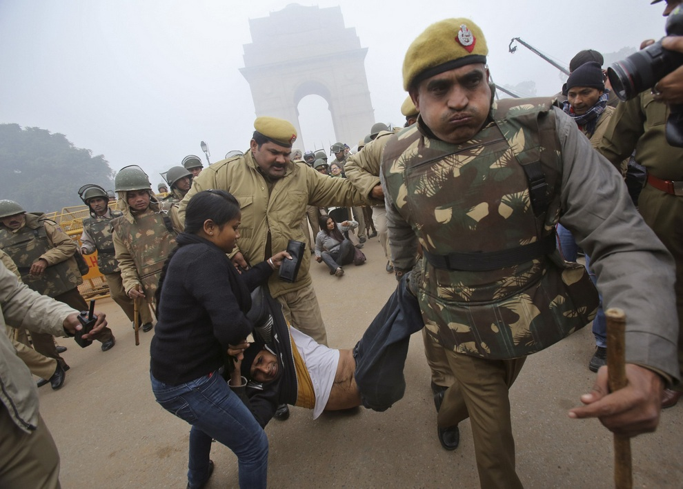 Police detain a demonstrator in front of the India Gate during a protest in New Delhi