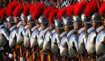The thirty new recruits of the Vatican's elite Swiss Guard stand at attention during a swearing-in ceremony in Saint Damaso courtyard at the Vatican