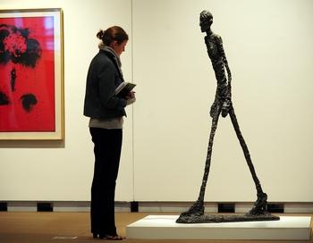 """""""L'Homme qui marche I"""", a sculpture by a"""