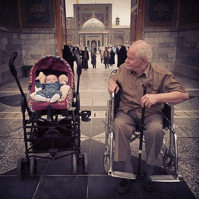 Grandpa and grandson at the doorway of Imam Reza's Shrine Iran
