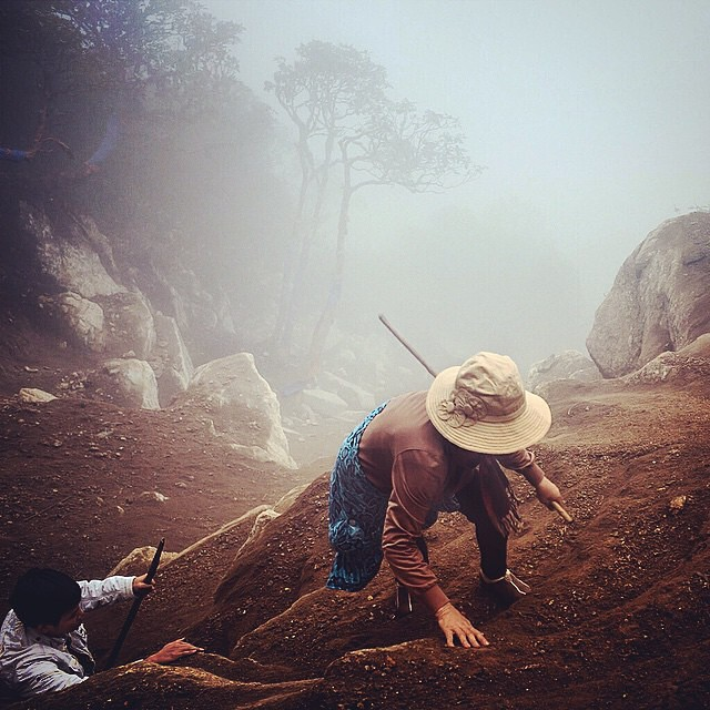 Vietnam. Tourists climb the sandy slope