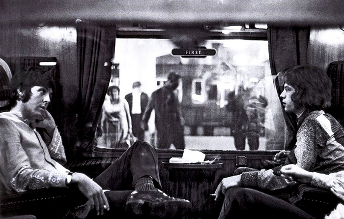 Paul And Mick Jagger On A Train At Euston Station (1967)