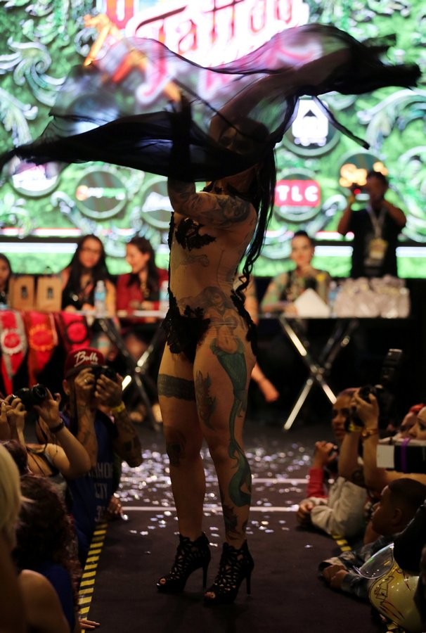 A tattooed model performs during the Tattoo Week SP 2016 in Sao Paulo, Brazil, July 23, 2016. (Photo by Paulo Whitaker/Reuters)