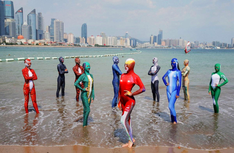 "Pic shows: Zhang Shifanâs sixth-generation facekinis. A woman credited with inventing the bizarre swimwear known as the ""facekini"" has now proudly presented the sixth generation of the iconic beach clothing. The new facekini models are not only more comfortable, they also come in a wider variety of colours and patterns, bringing both style and practicality to beach-goers in Qingdao City, in East Chinaâs Shandong Province, who fear tan lines. While first-generation facekinis designed by 60-year-old Zhang Shifan were â as the name suggests â only headwear, later versions transformed the concept into a full-body swimsuit. The facekini ""invasion"" started several years back on the popular beaches and at crowded resorts in Qingdao City, but soon spread to the rest of China. Like many great inventions, Zhang created a market where there was none by convincing her countrymen of the need to protect themselves from harmful ultraviolet rays and stinging jellyfish in the seas. Several beach-goers were already doing this by bringing umbrellas and buying long-sleeved swimwear for their seaside holidays. Despite being ridiculed the world over, love for the clothing, which was once only worn by middle-aged women, has taken on a life of its own and is now also used by the younger generation as well as men. Zhangâs sixth-generation facekinis are now appealing to the youth of China by featuring animal prints on the back such as giant pandas, alligators, and Siberian tigers. By including some of the worldâs rarest animals on the back of the full-body suits, Zhang hopes to preach wildlife conservation at the same time. Her newest facekinis are a stunning array of designs and patterns, which have to some extent become the go-to fashion statement every summer. (ends)"