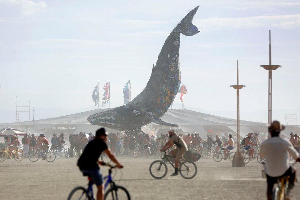 Participants gather around The Space Whale art installation as approximately 70,000 people from all over the world gather for the 30th annual Burning Man arts and music festival in the Black Rock Desert of Nevada
