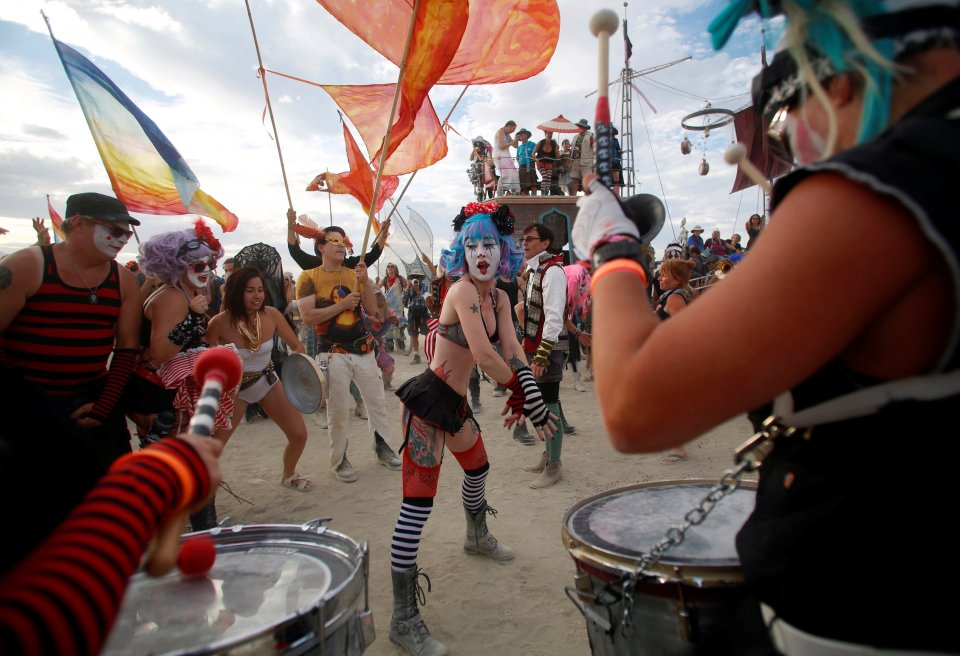 Members of the Trash Kan Marchink Band perform as approximately 70,000 people from all over the world gather for the 30th annual Burning Man arts and music festival in the Black Rock Desert of Nevada