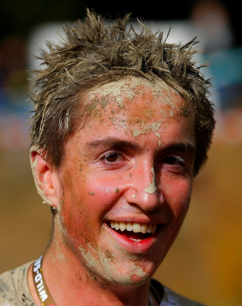 A competitors is seen after finishing the Wildsau Dirt Run (Wild Boar Dirt Run) obstacle course fun race at Hellsklamm ravine in Obertriesting, Austria, October 22, 2016. (Photo by Heinz-Peter Bader/Reuters)